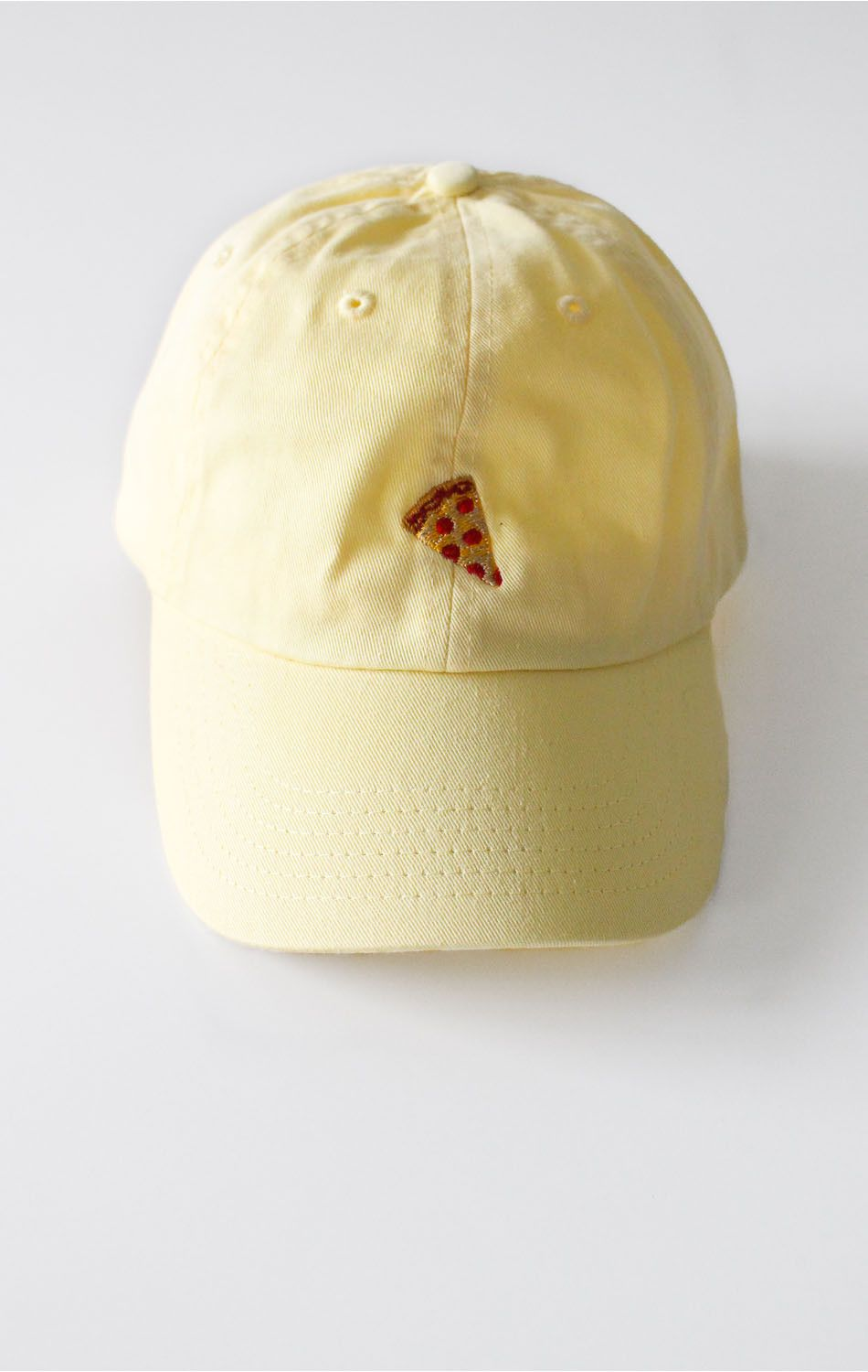 - Description Details: Yellow six panel baseball cap with 'Pizza' embroidery & adjustable back with tri-glide buckle. 100% Chino Twill. Imported. All accessories are final sale. Sizing: Adjustable, 2