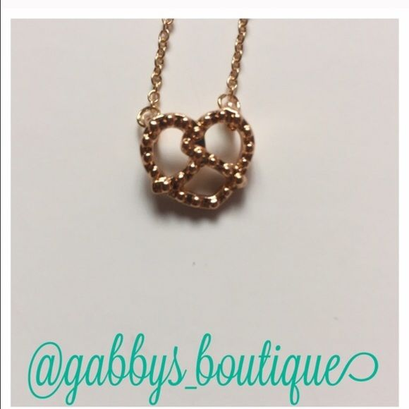 """Gold pretzel necklace New in packaging. Metal is zinc alloy. Length is about 18.5"""". No trades Jewelry Necklaces"""