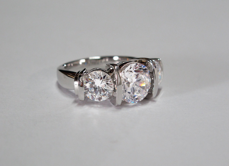 bar set 3 stone diamond engagement ring