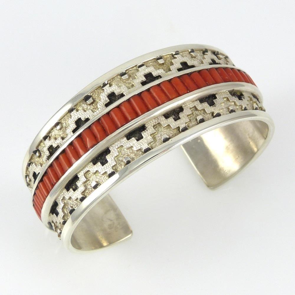 Cuff | Dan Jackson (Navajo). 'Navajo Rug'.  Sterling silver with patina and coral.