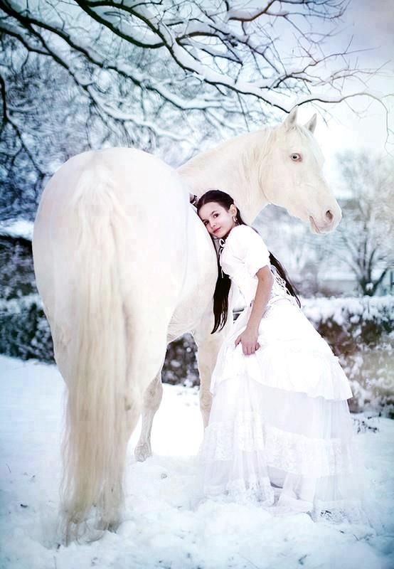 Girl with her white horse