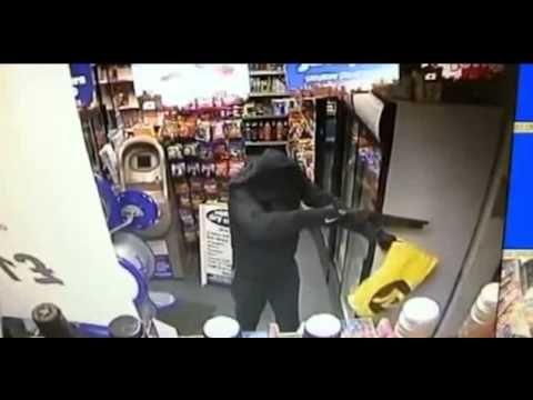 CCTV: Unarmed mother fights off shotgun robber