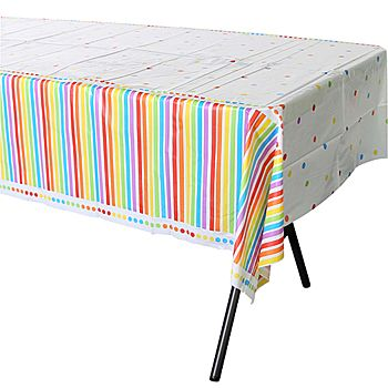The Rainbow Birthday Table Cover boasts a vividly colored design of stripes and polka dots. This table cover is made of plastic and measures 54 inches wide.