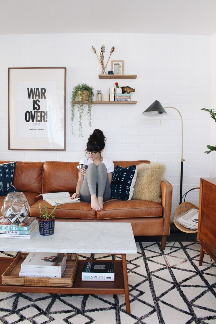 Midcentury Boho Living Room With Leather Couch Open Shelves And Wall Art