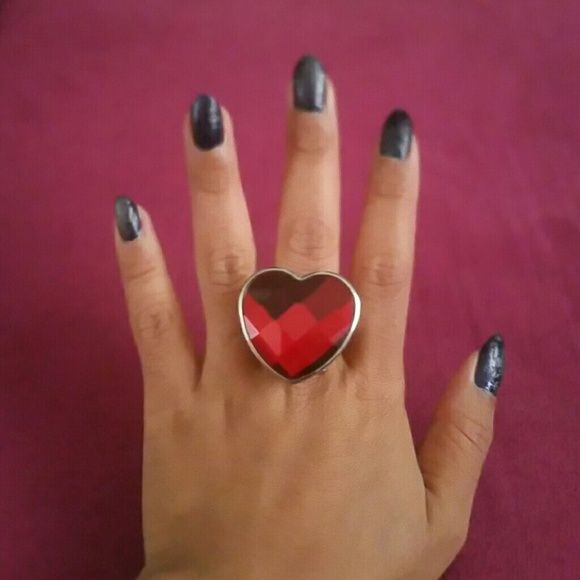 Red heart ring watch Band is stretchy. Catches anyone attention. Lift open to reveal a clock inside. Batteries are dead but you can buy a replacement battery if you want the clock to work or you can wear as it. Stainless steel. Accessories Watches