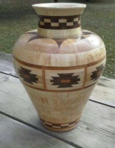 Segmented vase made of Curly Maple, Cherry, Walnut.