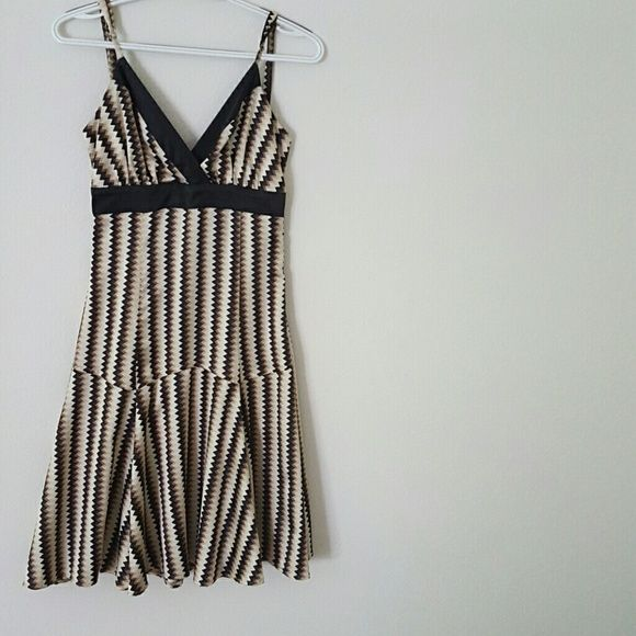 Elegant Silk dress Perfect like new condition, only wore once for my engagement party and has been in the closet since. Very soft and comfortable,  hugs your body perfectly. Zipp closure in the back, adjustable straps. Bought it in Europe so it says size small, fits a size 2-4 Dresses Midi