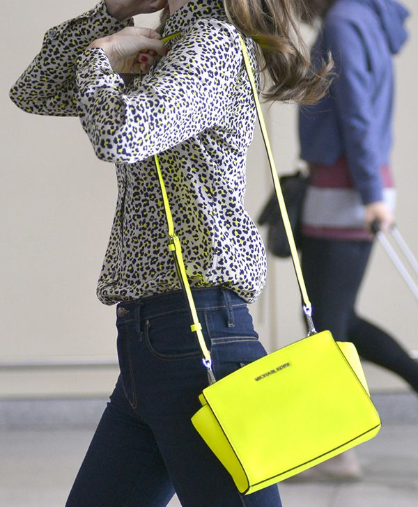 e9ef1d1601 ... Bag · Miranda Kerr carrying a neon yellow Michael Kors .
