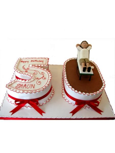 A lovely large birthday cake decorated with the number 50 and with