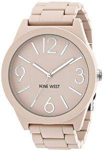 6f5686fde60c6 Amazon.com  Nine West Women s NW 1679PKPK Matte Pink Rubberized Bracelet  Watch  Watches
