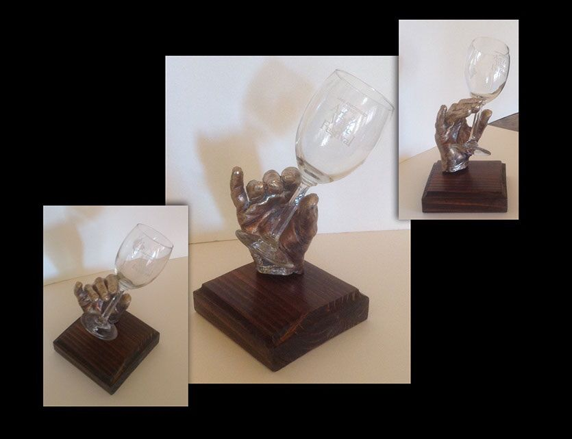 """""""Cheers"""" bronze hand holding a wine glass. Black marble base. Approximately 6""""long x 5"""" wide x 8"""" tall. Go to www.handsonart.biz to see more sculptures by Brenda Buffalin."""