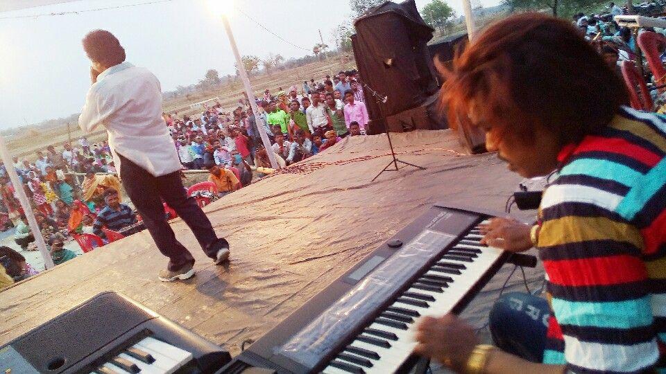Laxman Murmu & Singrai Soren performing on a stage.