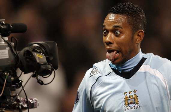 Manchester City's Robinho reacts into a television camera after scoring against FC Twente during the... - Paul Thomas/AP Photo