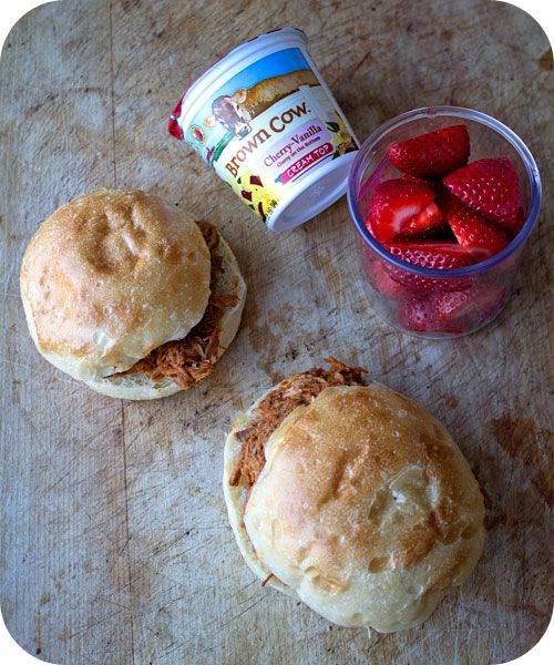 Easy lunch box ideas: two barbecue pulled pork buns with butternut squash; strawberries; and a yogurt. http://www.LunchBoxBlues.com