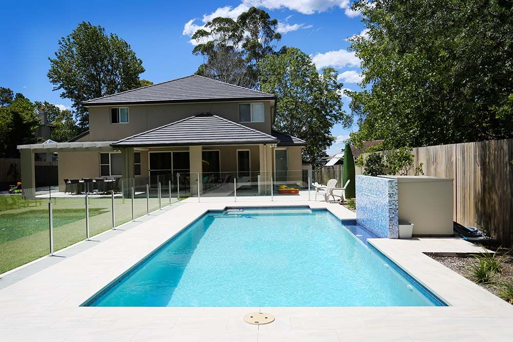 Wahroonga swimming pool half yard glass fence paved for Domestic swimming pool design