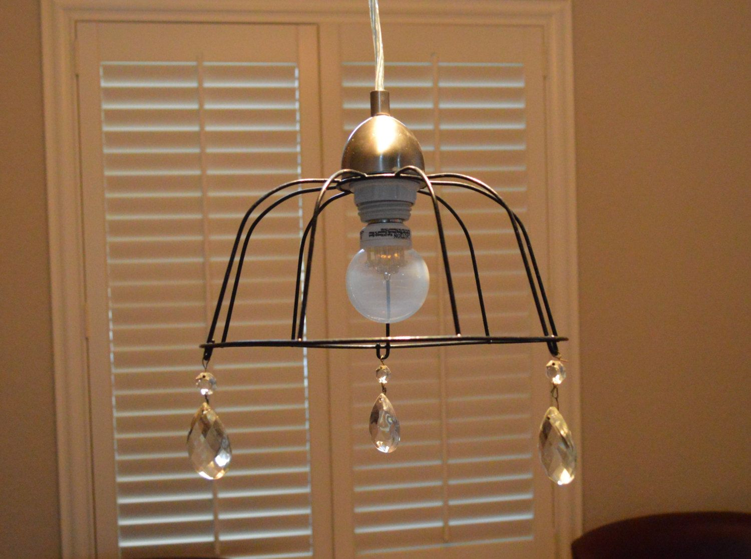Black wrought iron basket pendant lamp with vintage crystal glass