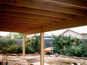 A Solid Roof Patio Cover Under Construction Pergola Curved Pergola Wooden Patios