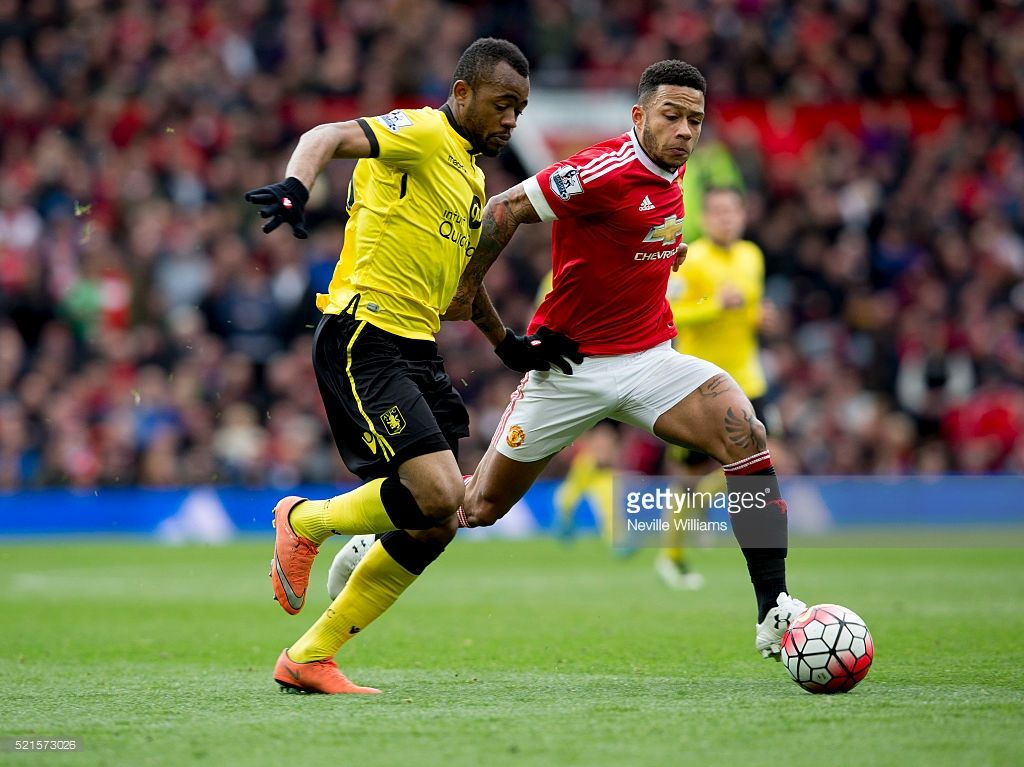 Jordan Ayew of Aston Villa is challenged by Memphis of Manchester United during the Barclays Premier League match between Manchester United and Aston Villa at Old Trafford on April 16, 2016 in Manchester, England.