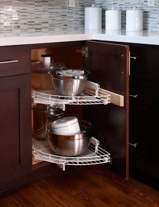 8 Ingenious Organizing Ideas For Corner Cabinets Corner Kitchen Cabinet Kitchen Cabinet Storage Small Kitchen Storage