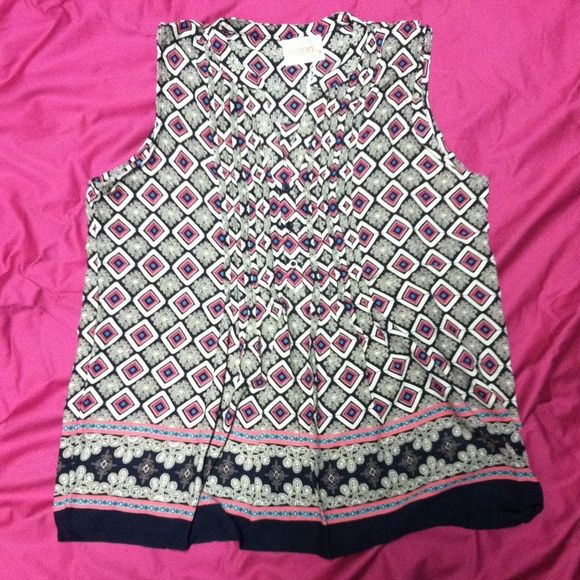 Short Sleeve V Neck Top This gorgeous retail shirt is silky smooth and incredibly stylish. All shirts offered for sale are still in plastic wrapping with tags and a button for repairs. Currently I have 3 smalls and 2 mediums available Moon Collection Tops Blouses
