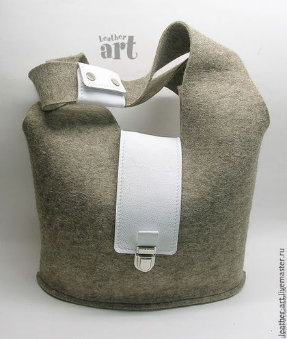 Buy or order Feld bag 'Gray hare' in online shops on My Livemaster. A lady's bag made of felted grey fabric. Decorated with a leather flap. Zipped up on a bronze buckle-lock and with no lining inside. Has 2 handles and 2 leather pockets inside, can be worn both in a hand or on an elbow. Has a rectangular shape of the bottom. Stitches are out. Can keep its shape even if it's empty. Woolen, amuzing and lovely, especially for cold winter times.