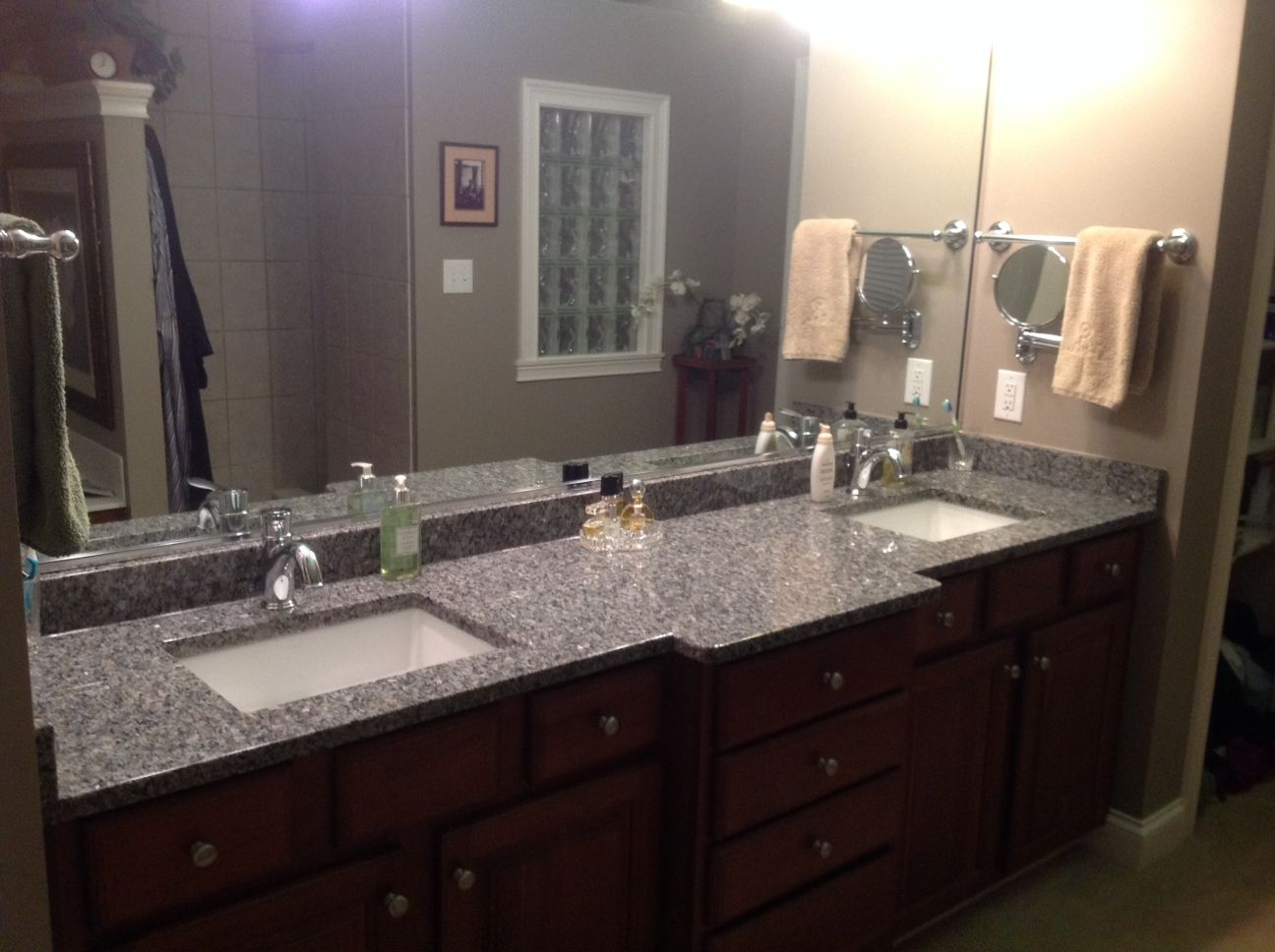 New caledonia granite bathroom vanity natural stone from levantina chicago install by olympia stone