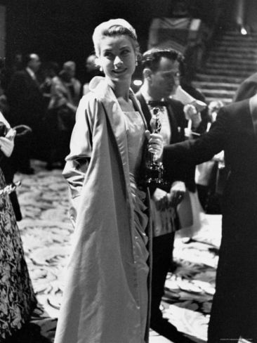 Grace Kelly Holding Her Best Oscar Premium Photographic Print by George Silk at Art.com