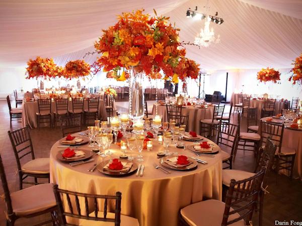 Orange floral centerpieces bitsy bride wedding dresses for Orange centerpieces for tables
