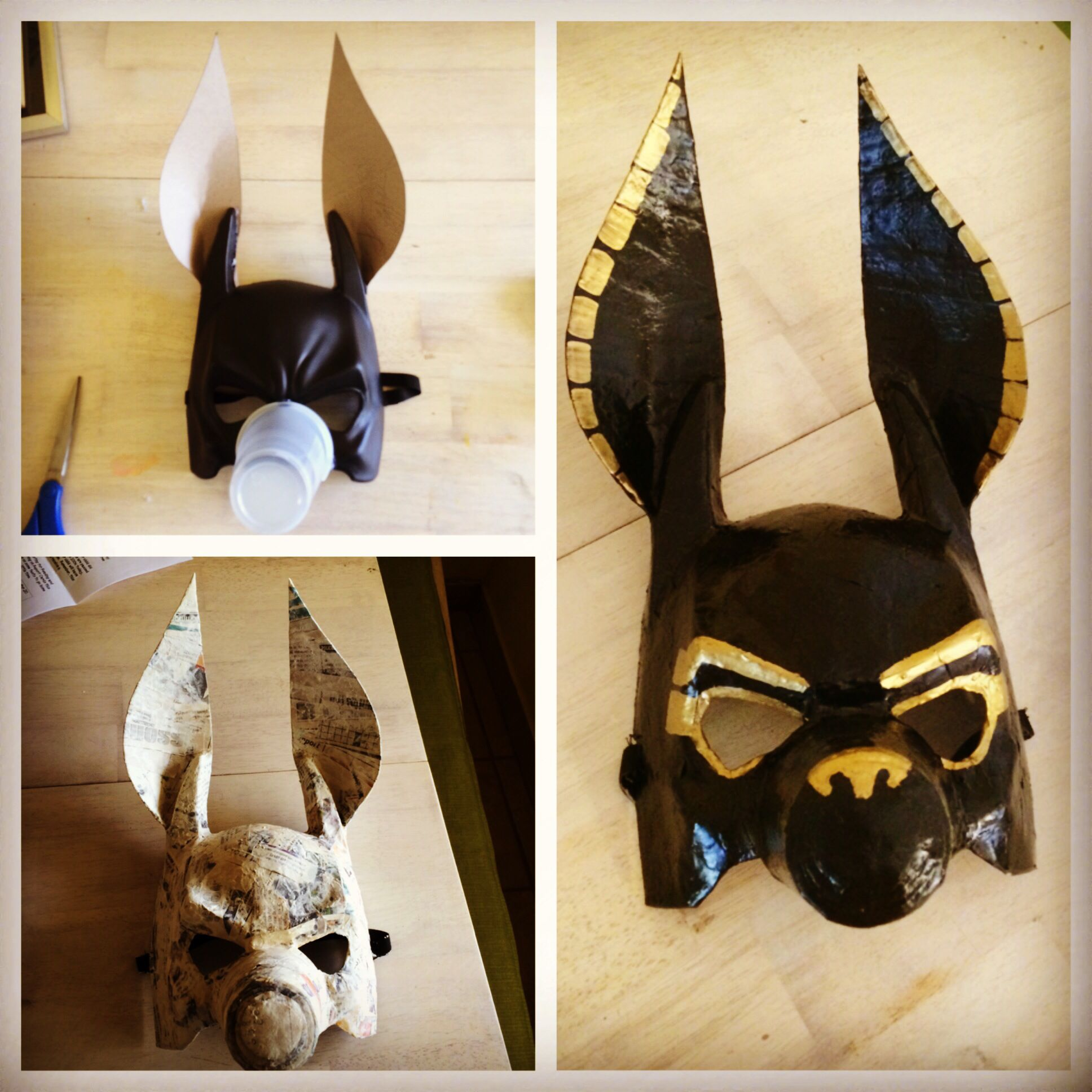 diy anubis maskmade from a plastic mask cardboard ears and a plastic cup paper mch and paint with gold black paint and done