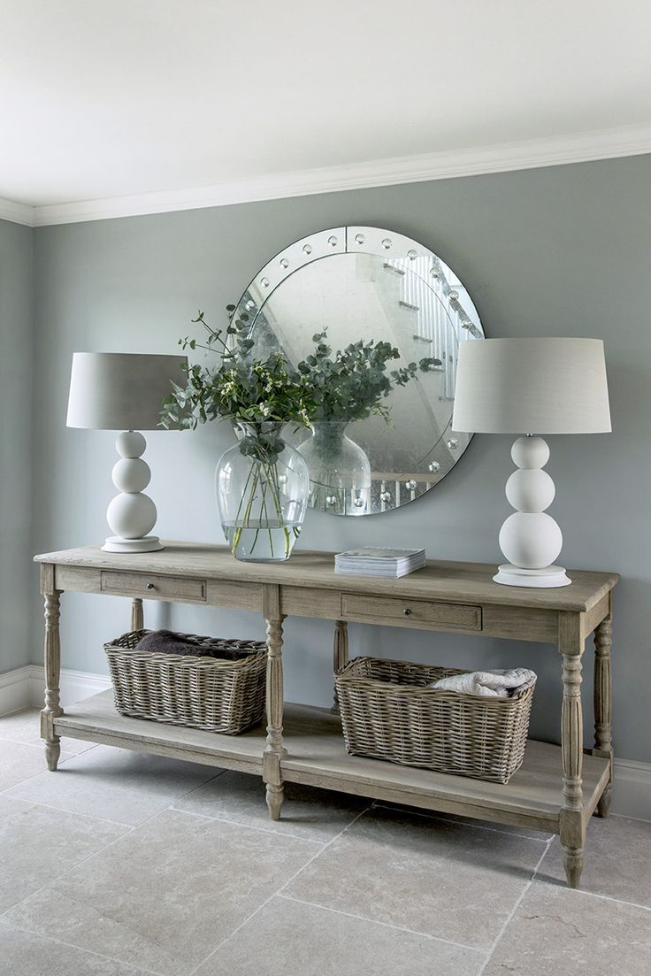 The garden house entrance hall with stone floor and a console table