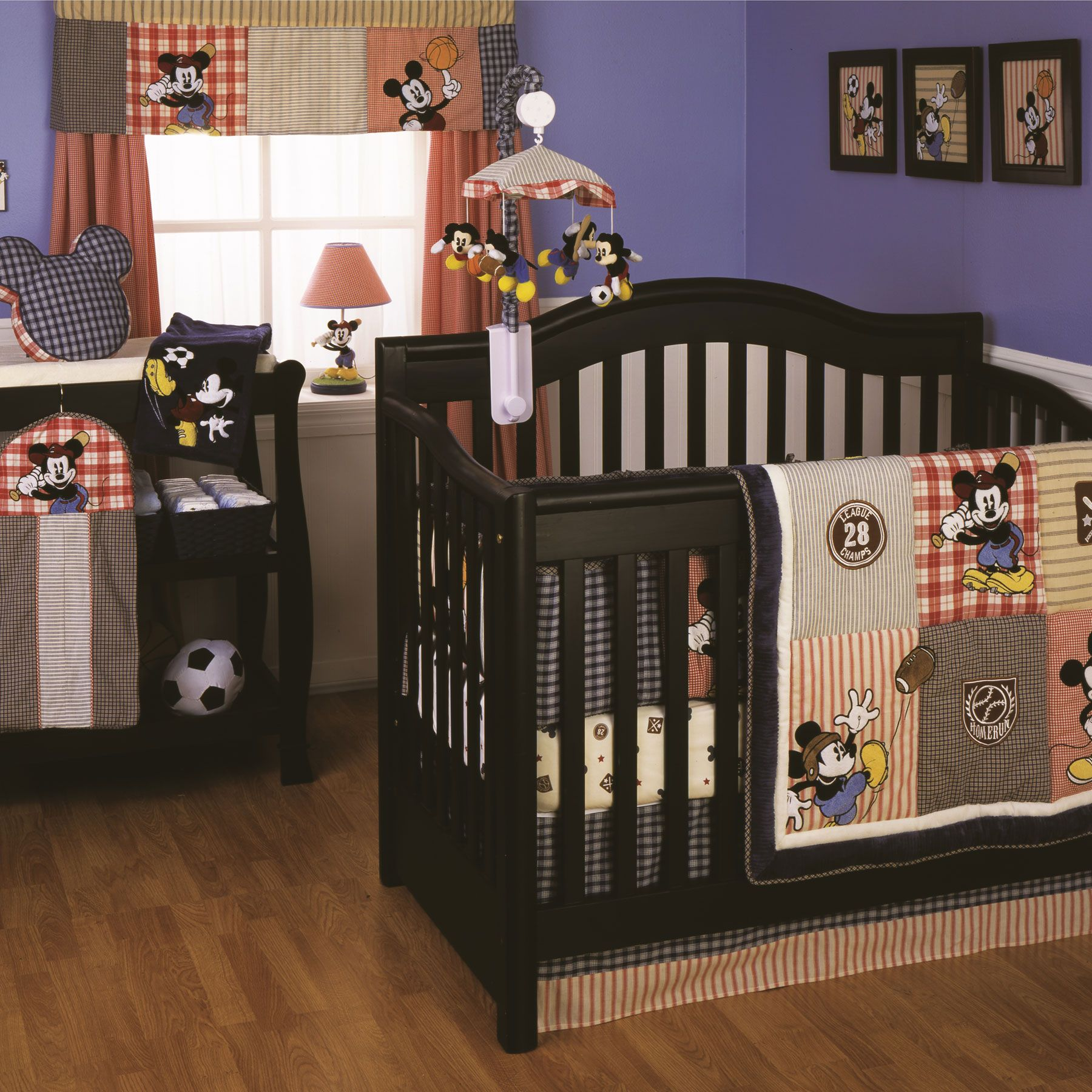 This Vintage Style 4 Piece Crib Bedding Set Showcases Mickey Mouse Showing Off His Athletic
