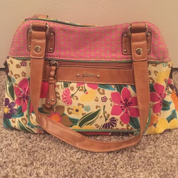 Flower patterned purse Like new Plum flower printed purse. Brown straps and green inside. Zipper pocket in the front and also pockets inside bag. Plum Bags Shoulder Bags