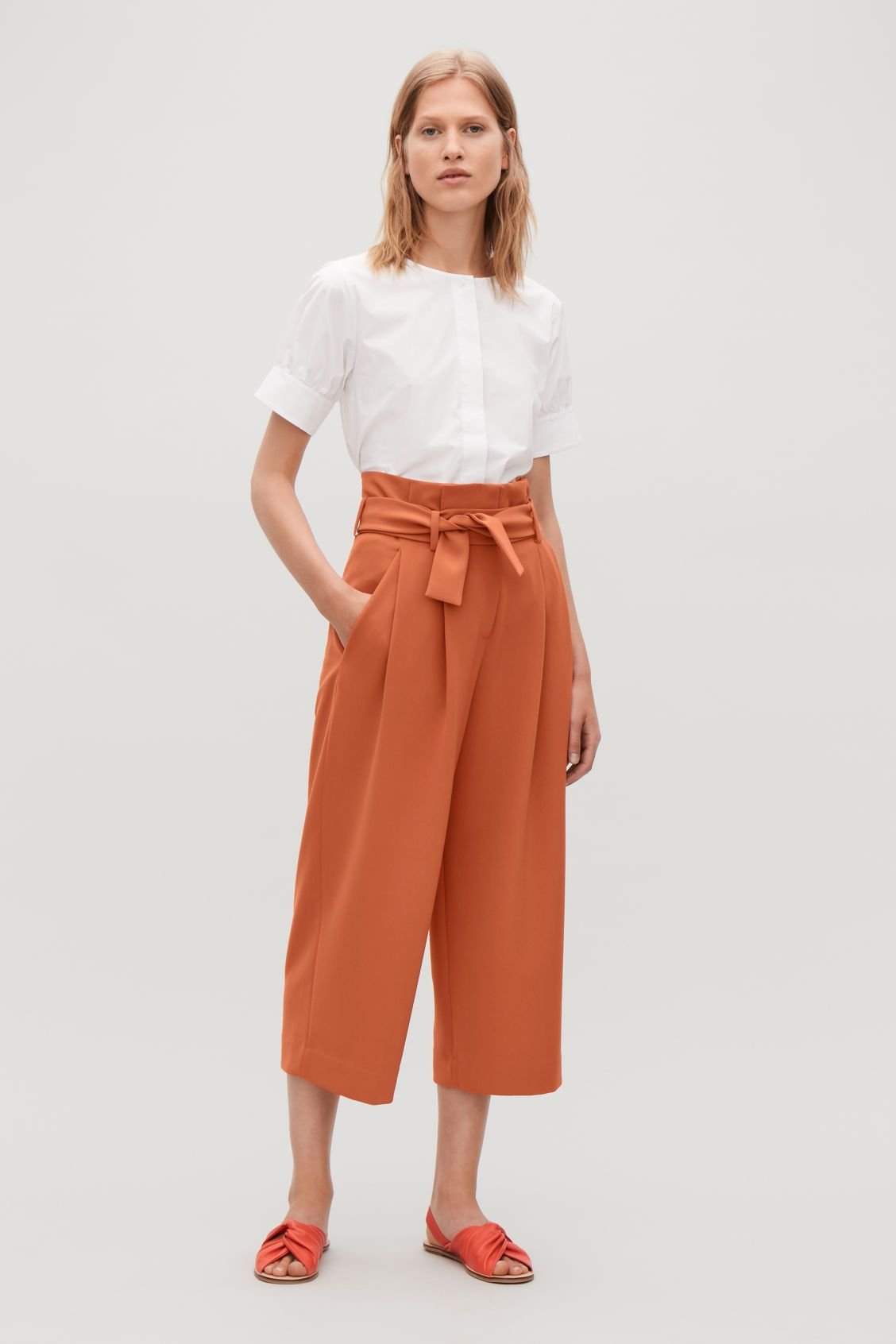 b7cfe65b6dbe BELTED HIGH-WAIST TROUSERS - Rust - Wide-leg trousers - COS US ...