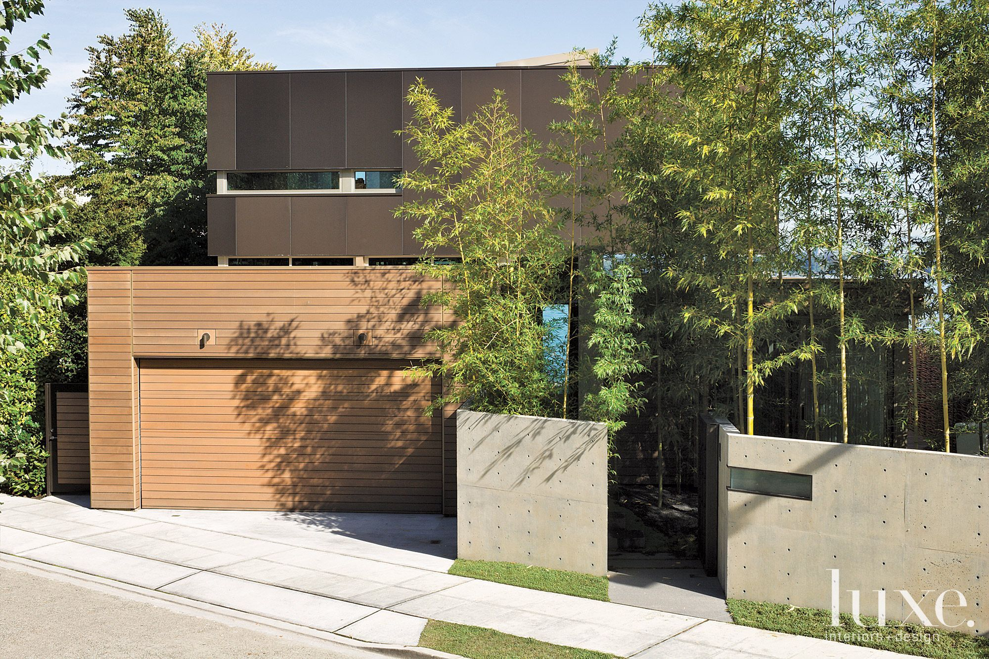 Stained Clear Cedar And Firestone Metal Panels Intermingle With  Architectural Concrete To Form The Sophisticated Mix Of Materials On The  Exterior Of This ...