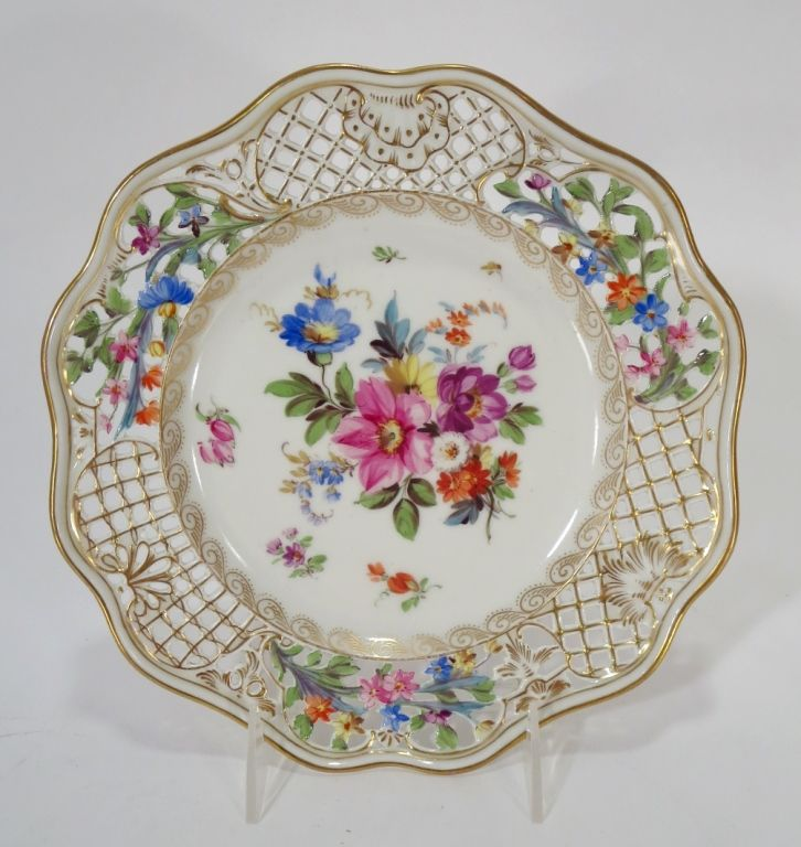 Carl Thieme Antique Saxon Porcelain Floral Plates with reticulated border, c.1880's, sold by Ovington Bros., New York. (13) (RIVERS4205/10)(WK) <br><br> Property Title: From the Estate of Joan Rivers.<br><br>Measurements: 9 Dia. In good condition.<br><br>Condition: