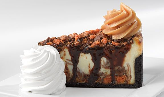 Adam's Peanut Butter Cup Fudge Ripple. Creamy Cheesecake Swirled with Caramel, Peanut Butter, Butterfingers® and Reese's Peanut Butter Cups®. from The Cheesecake Factory, USA.