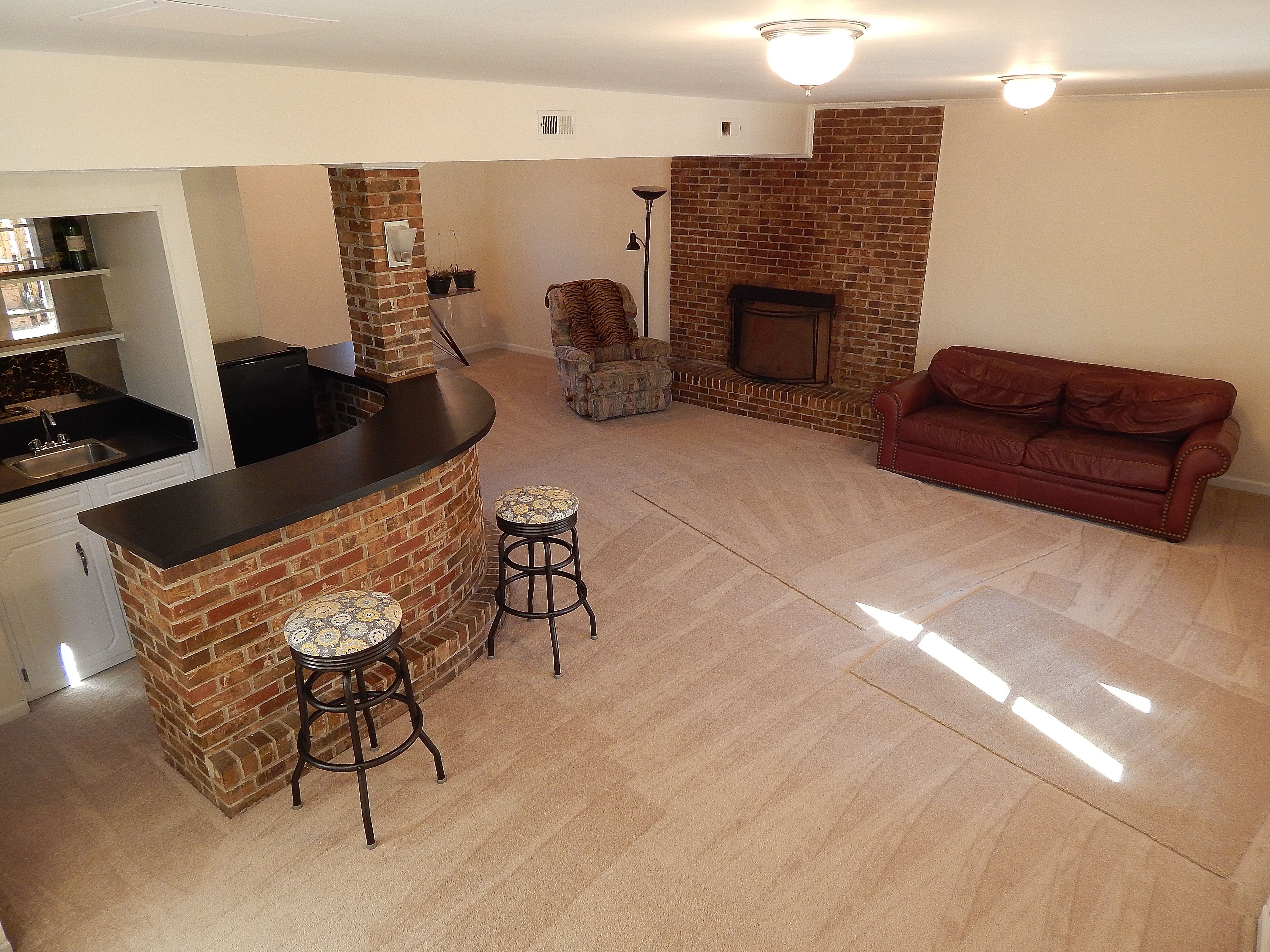large den downstairs features a brand new carpet fresh paint gas