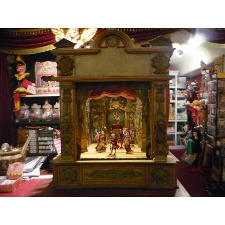 """19th Century German Theater featured at Pollocks in London (front view) - this """"Papiertheater"""" is c1890 and the wooden facade mimics and opera stage.  The play inside is from J.F. Schreiber and is about an enchanted toystore where the toys come to life when the fairy appears. www.pollocks-cove..."""