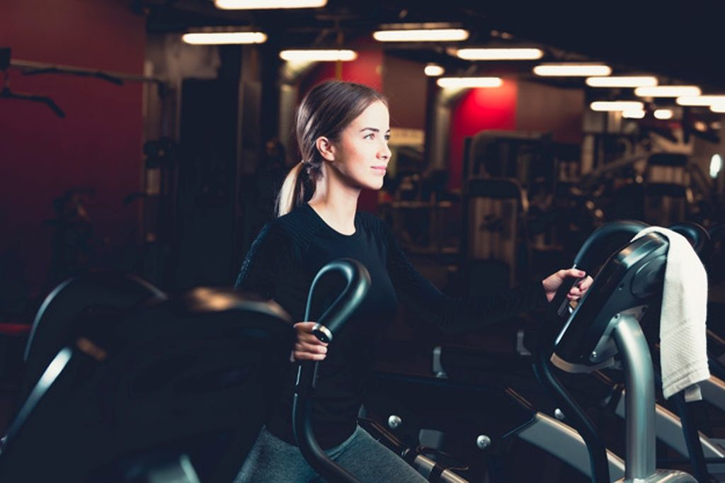 Woman cycling in fitness center #paid, , #ad, #Paid, #cycling, #fitness, #center, #Woman