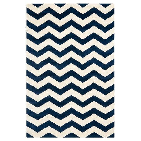 Showcasing chic chevrons in blue and ivory, this hand-tufted wool rug brings bold geometrics to your decor. Use it to define areas in the lounge, or pair it ...
