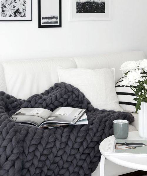 """This incredible, hand-knit piece is more than a blanket - it's a work of art and a beautiful addition to your home decor! Available in 4 colors. DETAILS: 55"""" x 70"""" 100% merino wool Hypoallergenic Dry"""