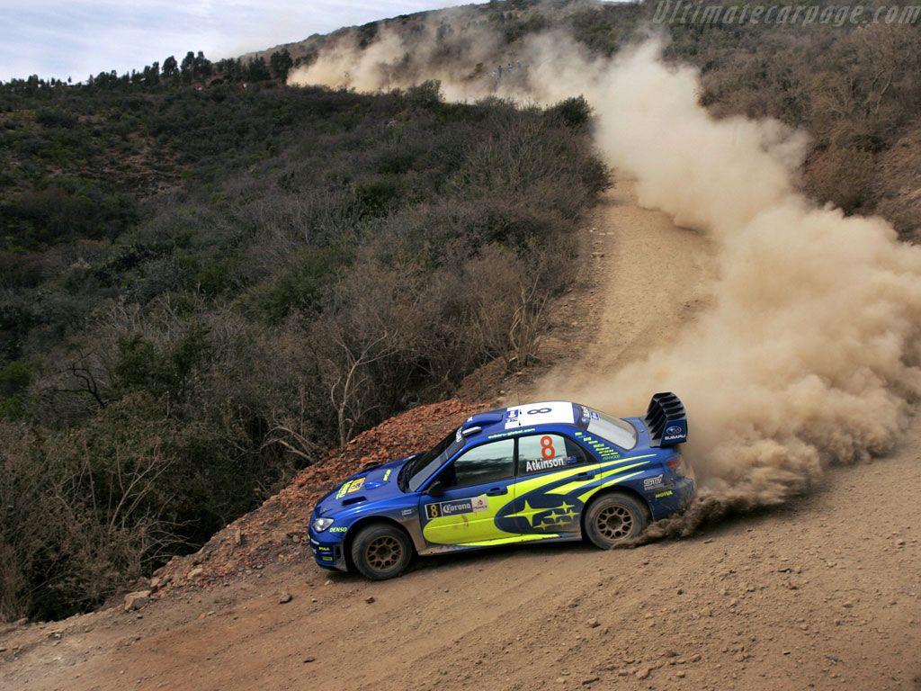 Subaru impreza wrx sti sliding a corner on a hill climb