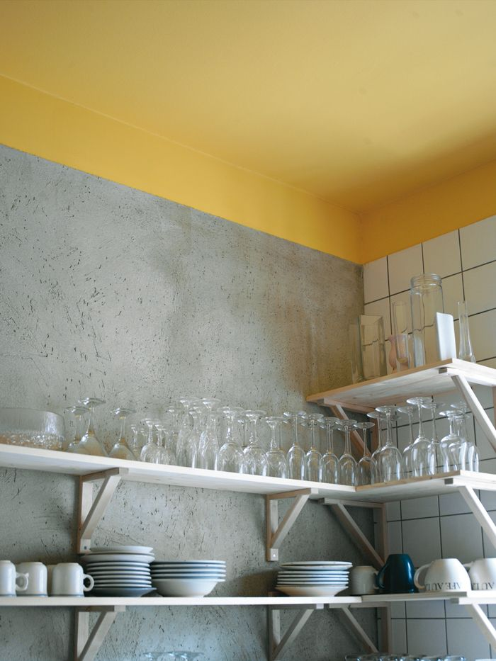 love the yellow with the cement gray & white subway tile ...