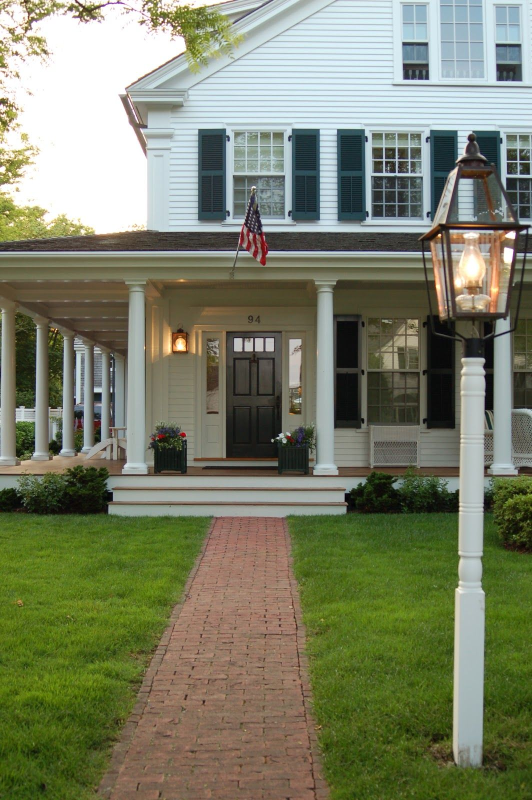 Traditional white house with black shutters and big front for Farmhouse front porch pictures
