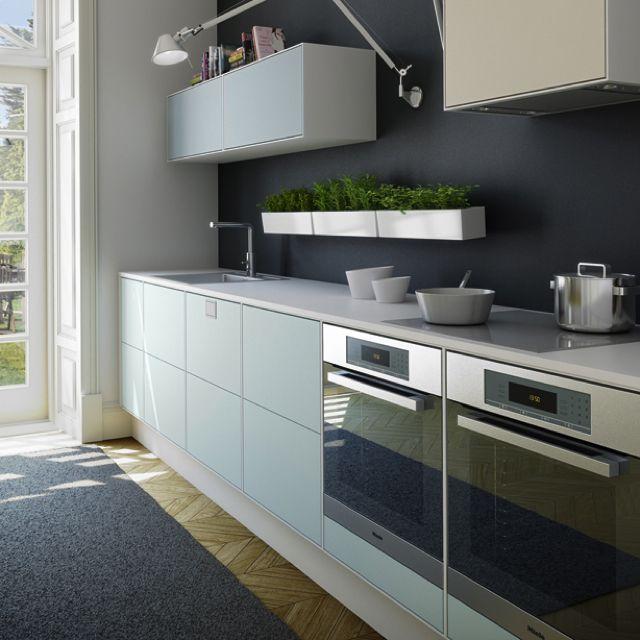 Svane Kitchen. Light blue and dark wall.