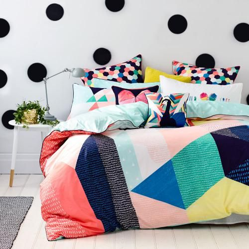 Unlike anything you've seen before, the Coco Quilt Cover Set features a strikingly unique combination of geometric shapes in bold, block colours. With a contrasting triangle print reverse on a cool mint base, this design from our exclusive teen range – Ruckus, offers both style and versatility. Mix and match with cushions and fun, Text pillowcases also available in the Ruckus range.