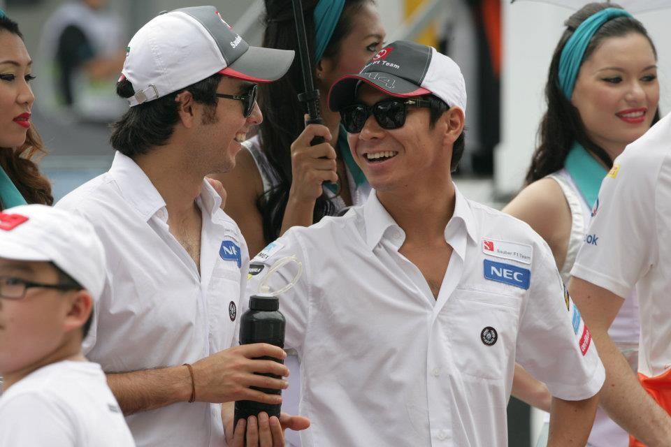 Checo Pérez and Kobayashi Kamui during the drivers' parade
