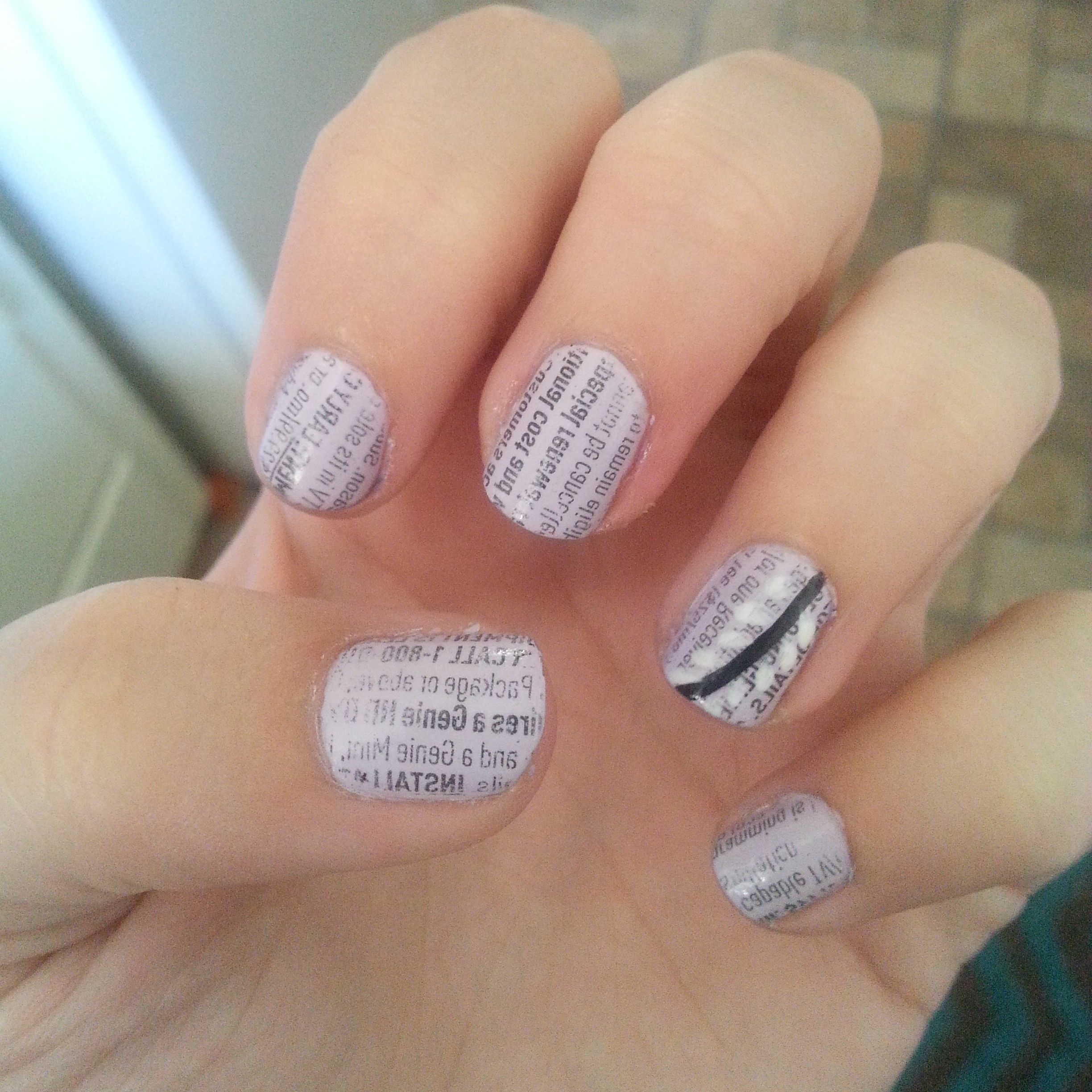 Newspaper nails...plus my design :) Just dip newspaper clippings in ...
