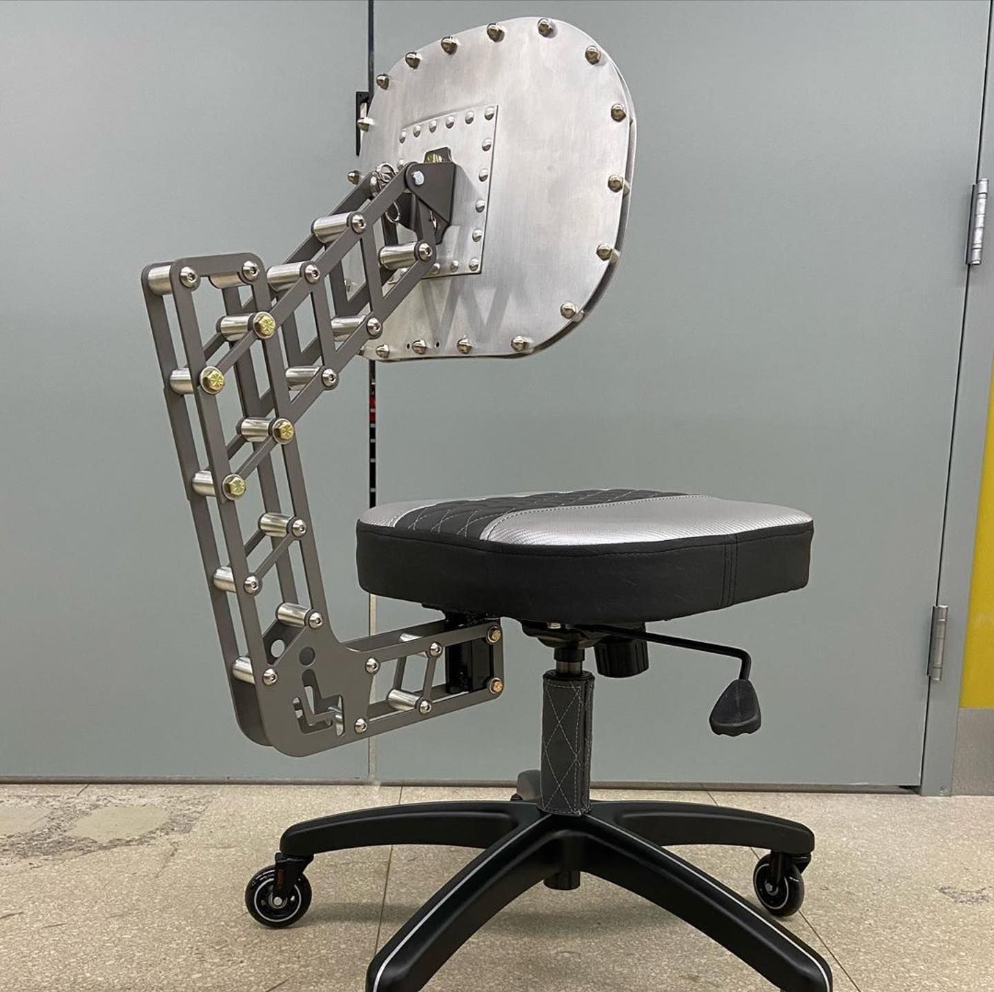 """Project of the week! Industrial tattoo chair by @niteowl_tattoo_furniture - so awesome. ・・・ It's FINALLY DONE.  The inventively named """"Sit Symbol Chair"""" with laser cut steel brackets.  It's a one-off design and is actually comfortable with good lower back support. . . . .  #customchair #industrialfurniture #customfurniture #industrialdesign #metalart #maker #stuffmadeinct #fabrication #customfabrication #fusion360 #mcmastercarr #metalwork #dimpledie #upholstery @sendcutsend @makerspacect #jarryr"""