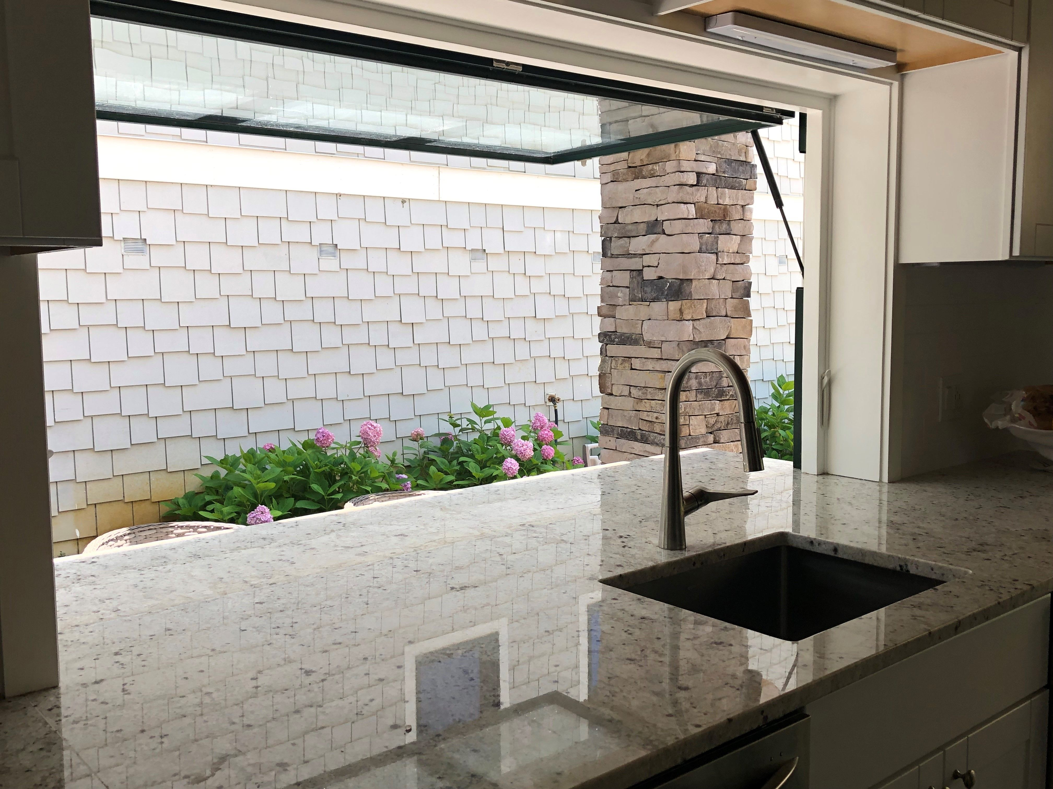this indoor outdoor countertop is one for the books this customer used our granite colonial on outdoor kitchen quartz id=15708